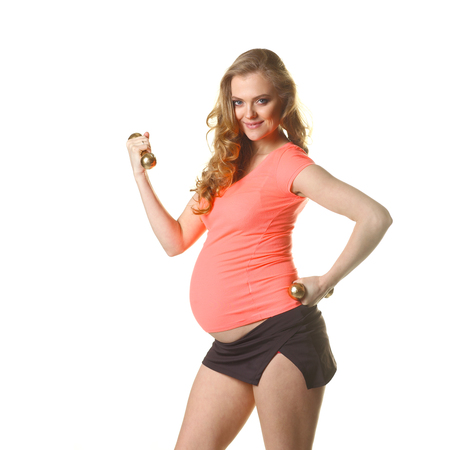 Pregnant woman in for sports. Pregnant woman doing exercise with dumbbells. Pregnant woman exercising with training weights