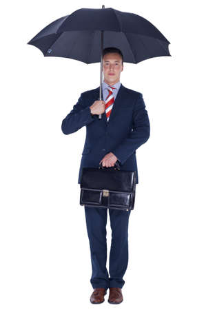 Manager stading under umbrella with a briefcase photo