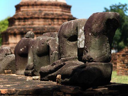 beheaded: Figures of Beheaded Buddha in ayuthaya, Thailand