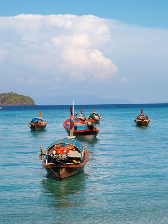 lookalike: a group of boats in the sea with a human face look-a-like cloud