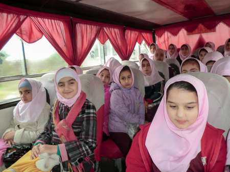 Elementary school services for girls. An Islamic school where girls should wear scarves and dress uniforms. Girl students in school service.