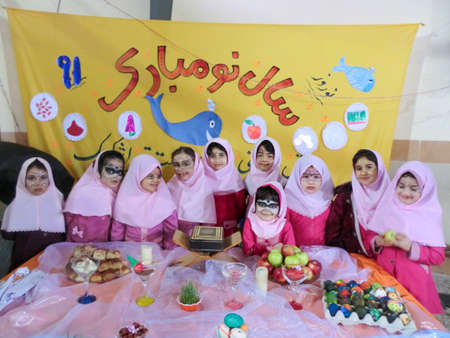Rasht, Gilan, Iran, 05 05 2019. New Year Celebration at Girls' School in Iran. Nowruz table party with female students. Painted faces of students at the celebration.