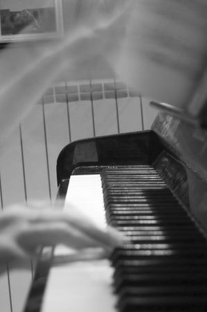 ivories: hands turning musical score page while playing