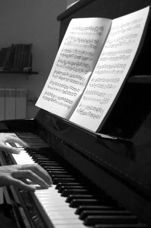 black and white portrait of hands playing piano photo