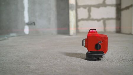 Laser equipment at a construction site Construction laser level in a building under construction. 스톡 콘텐츠