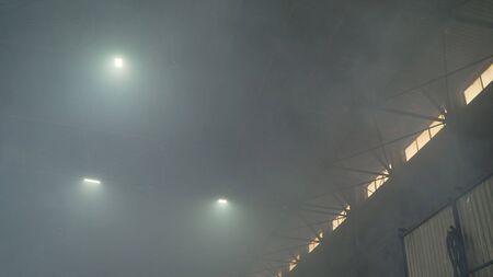 Smoking industrial chimneys at dawn. Concept for environmental protection. Industrial factory in smoke