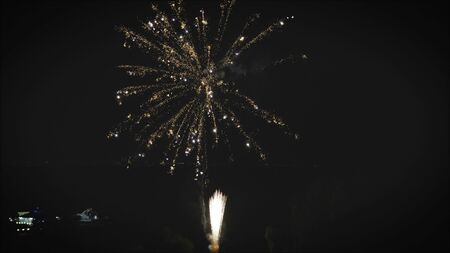 Bright salute. Powerful, expensive salute. Photographing of salutes and fireworks in the night sky celebrate data. Quadcopter and salute. Powerful fireworks in the night sky.