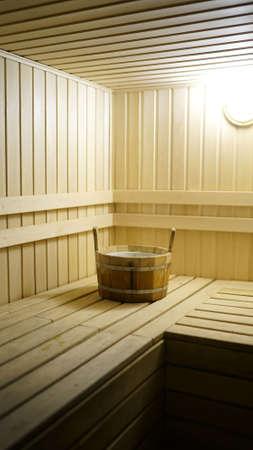 Sauna accessories are in the interior of the steam room. The interior of the sauna. Sauna from linden. Foto de archivo