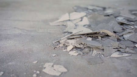 defective putty on the floor. Not high quality plaster. Poor quality putty on the floor. Repair and construction or construction work. Concrete background. Grey colour. Cement texture.