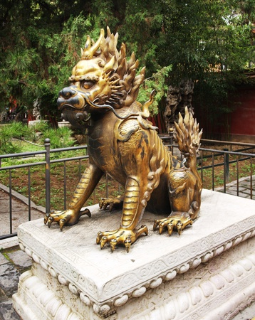 Bronze lion near the entrance to Emperor Temple in Forbidden City      Stock Photo