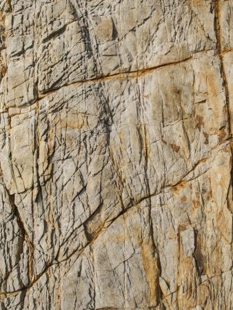 cranny: Cranny surface of brown stone  Stock Photo