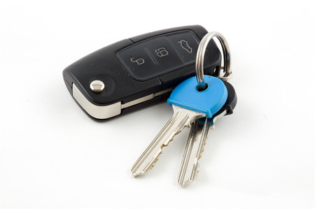 Car Key fob with House Keys on white background Stok Fotoğraf
