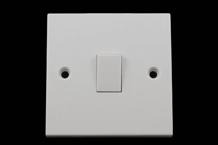 light switch: Isolated light switch Stock Photo