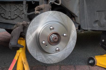 brake caliper: New Car Brake Disk  brake caliper removed Stock Photo