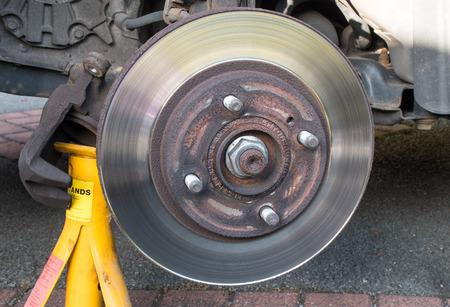 brake caliper: Worn Car Brake Disk  brake caliper removed Stock Photo