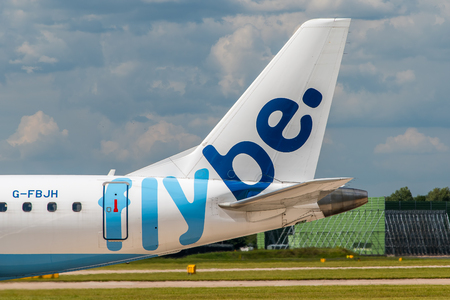livery: MANCHESTER, UNITED KINGDOM - AUG 07, 2015: Flybe Embraer ERJ-175 tail livery at Manchester Airport Aug 07 2015.