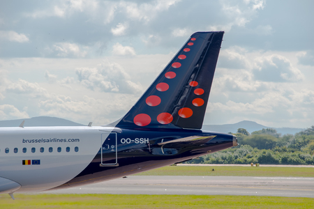 livery: MANCHESTER, UNITED KINGDOM - AUG 07, 2015: Brussels Airlines Airbus A319 tail livery at Manchester Airport Aug 07 2015. Editorial