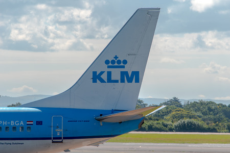 klm: MANCHESTER, UNITED KINGDOM - AUG 07, 2015: KLM Royal Dutch Airlines Boeing 737 tail livery at Manchester Airport Aug 07 2015. Editorial