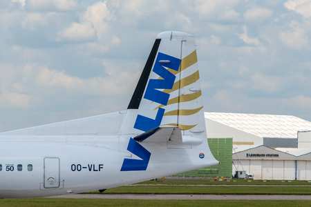 livery: MANCHESTER, UNITED KINGDOM - AUG 07, 2015: VLM Fokker F50 tail livery at Manchester Airport Aug 07 2015.