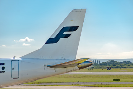 livery: MANCHESTER, UNITED KINGDOM - AUG 07, 2015: Finnair Embraer ERJ-190 tail livery at Manchester Airport Aug 07 2015.