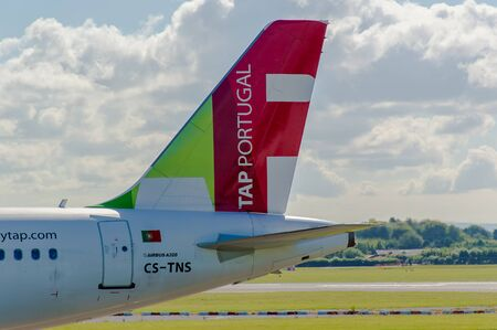 livery: MANCHESTER, UNITED KINGDOM - AUG 07, 2015: Air Portugal TAP Airbus A320 tail livery at Manchester Airport Aug 07 2015. Editorial