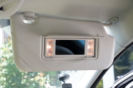 Car sun visor with illuminated mirror