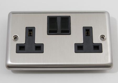 plug socket: UK Chrome Mains Plug Socket Stock Photo