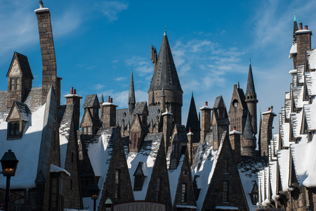 ORLANDO, USA - AUGUST 27, 2015: The Snow covered roof tops of Hogsmead at The Wizarding World Of Harry Potter at Universal Studios Orlando. Universal Studios Orlando is a theme park in Orlando, Florida, USA.