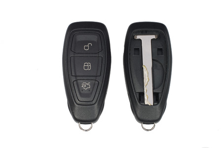 key fob: Keyless car key fob showing front and back with panel removed to show emergency key