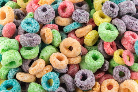 Coloured Fruit Loop breakfast cereal background Stock Photo