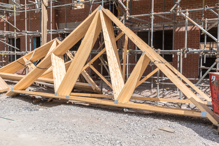 rafters: Houses under construction with roof trusses ready to install