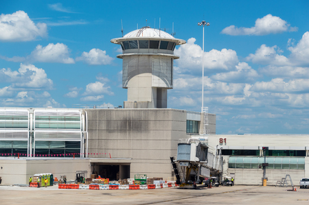 Image of a control tower and departure gate air bridge at Orlando Airport.