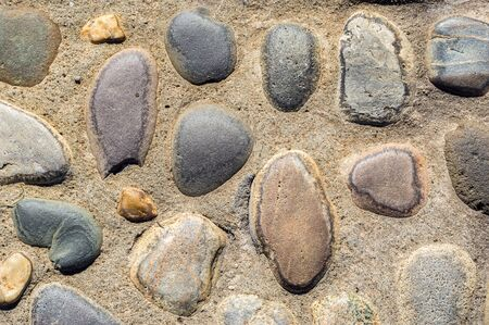 Stone pebbles set in the ground