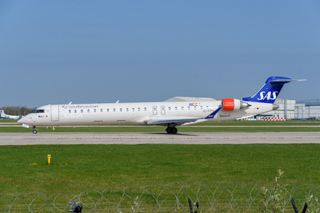 MANCHESTER, UNITED KINGDOM - APRIL 21st, 2018:  Scandinavian Airlines Bombardier 900 ready to depart at Manchester Airport