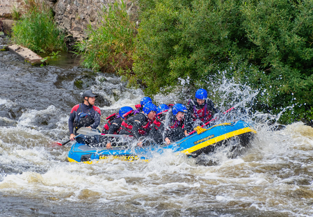 LLANGOLLEN WALES UNITED KINGDOM - AUGUST 27 2018: White water rafting through rapids on the River Dee
