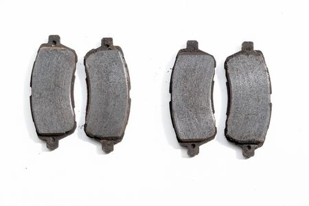Worn out old rusty brake pads removed from a car