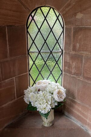 Pretty flowers set in a chruch window