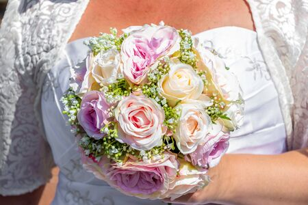 Close up view of a bride holding a  flower bouquet