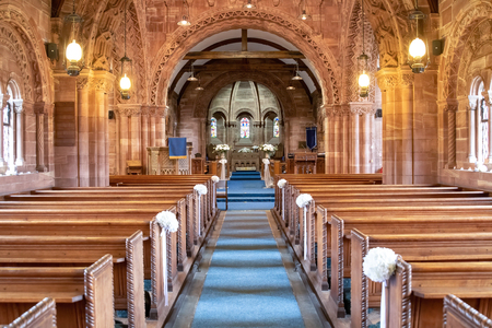 WIRREL,  UNITED KINGDOM - JULY 06, 2019: Interior view of a church looking down the aisle Редакционное