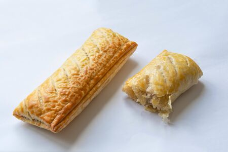 Cooked sausage rolls on a white background Standard-Bild