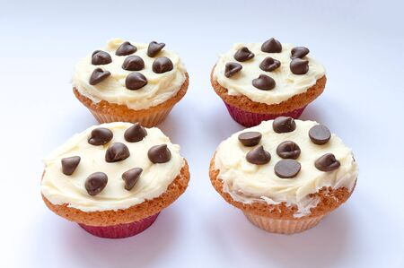 Homemade cupcakes with a buttercream frosting and chocolate chips