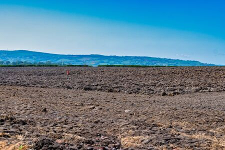 Rough Ploughed field in the countryside Standard-Bild - 145109660