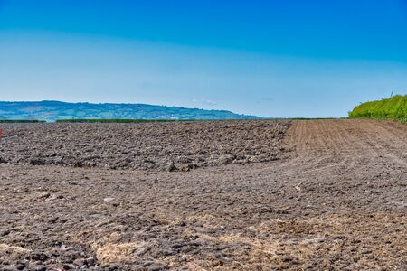 Rough Ploughed field in the countryside Standard-Bild