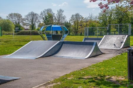 Skate board ramps in a playing park