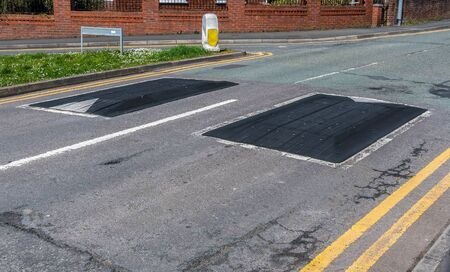 Rubber road bumps, humps in the middle of the road to reduce speed