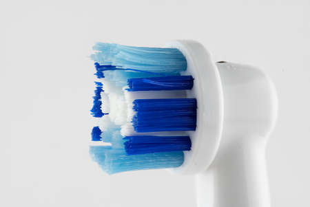 Close macro image of an electric toothbrush head