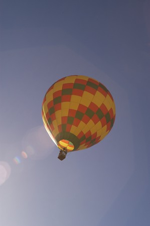blossom time: Low angle view of a hot air balloon in the air at the Blossom Time Festival in Chagrin Falls, Ohio. Vertical shot. Stock Photo