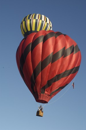 Low angle view of a hot air balloons in the air at the Blossom Time Festival in Chagrin Falls, Ohio. Vertical shot. photo