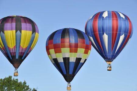 Three hot air balloons in flight  Sajtókép