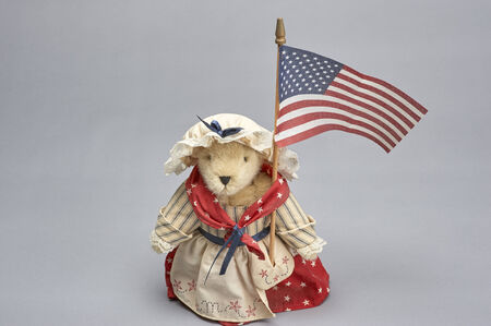 public spirit: Bear Doll dressed in red, white and blue holding American flag Stock Photo